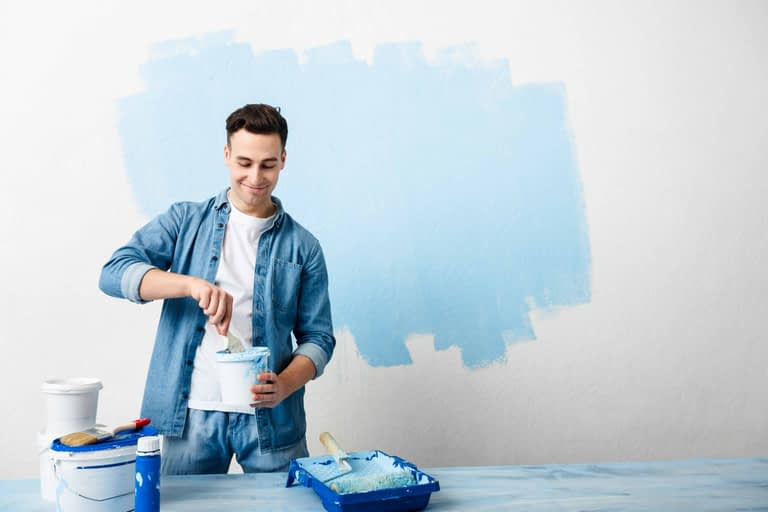 happy guy mixes pigment for paint wall TDYL26T scaled